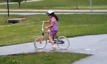 J on her bike